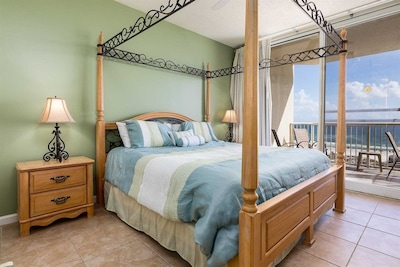 Master canopy bed with view of ocean