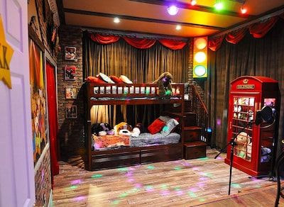 This bedroom even has a stage and disco lighting!