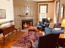 The living room, with views of the river, is furnished in18th-century style.