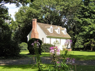 The Cottage in Summer from across the back lawn.