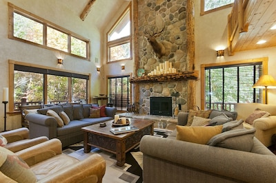 Nestled among the tree tops, this room is warm and inviting