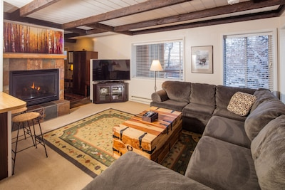 Living room, gas fireplace, 55 inch 3d  smart TV with DVR, comfortable seating.