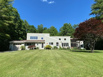 The house sits on 3 1/2 very private acres in a parklike setting.