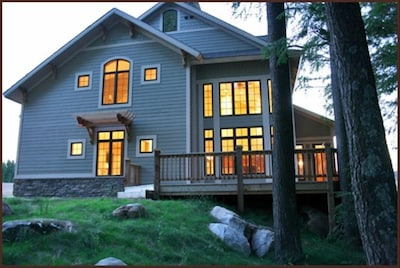 Wrap-around deck and two-story windows facing lake, private firepit and dock.