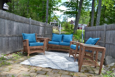 Lakeside patio area with comfy seating.