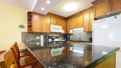 Fully equipped kitchen with granite counter tops and large refrigerator