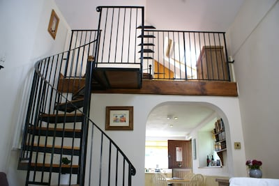 The spiral staircase and galleried bedroom