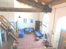 Living room of the ground floor with roof fan and big TV