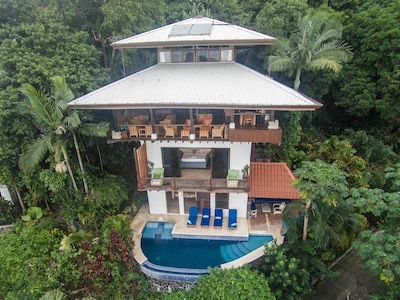 This amazing villa is perched on a hillside overlooking the Pacific Ocean.