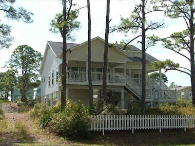 Front Balcony (Left) Bay View; Exterior Rear Master Bedroom Window Gulf View