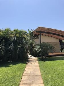 Home entrance. Designated massage area on the right.
