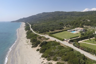 Aerial view of the villa, set between sea and olive groves