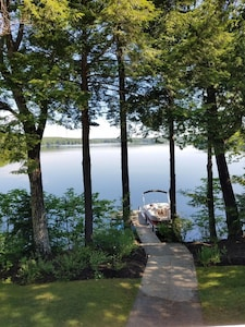View of Middle Range Pond from the porch (boat not included with home rental)