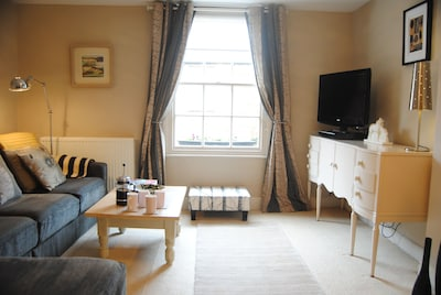 Spacious lounge overlooking the high street