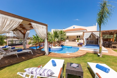The pool terrace is equipped with sun beds.