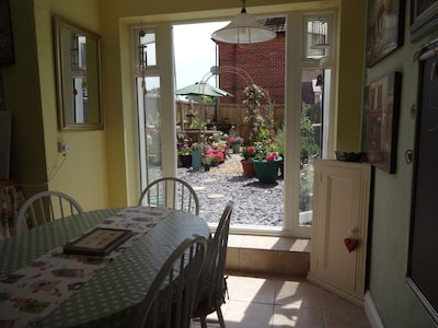 Sun Room for Dining with patio doors out to the enclosed south facing garden.