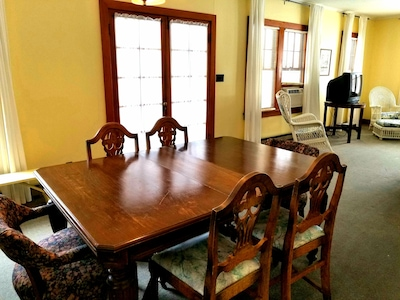 Dining room can fit 6 people comfortably.