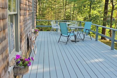 A large sunny deck with plenty of room for everyone