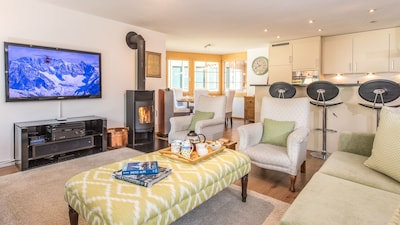 "Living room has a 55"" home cinema system and a wood-burning stove"
