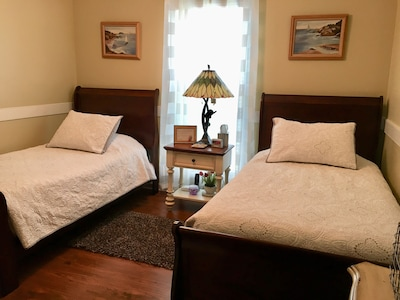 Two twin size bed with Tempur-pedic mattress. Plus Linen w/Duvet covers & towels