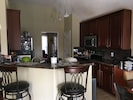 Kitchen area w/electric stove, oven, dishwasher and microwave.
