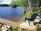 Lakeside deck, dock  & sand bottom swim area - comes w/2 canoes, kayak & paddleb