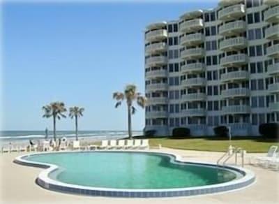 View of pool and building looking toward ocean