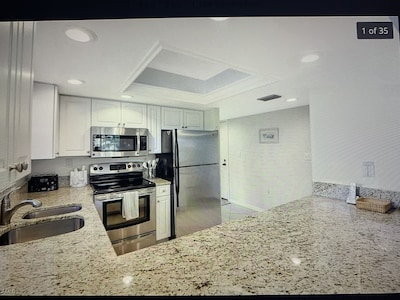 Updated kitchen with granite counter tops, stainless steel appliances