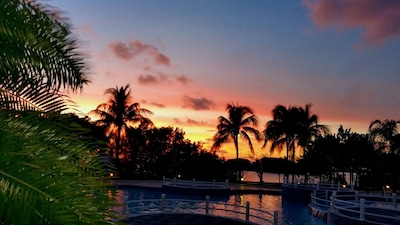 Pool With Ocean Sunset