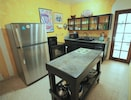 Our well equipped kitchen lets you cook meals in, saving hundreds of dollars.