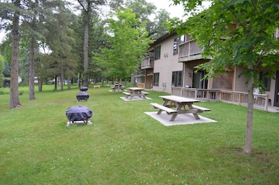 """Guests enjoy these """"party islands"""" - picnic tables and bon fire cauldrons"""