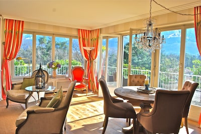 Spacious & Bright: Dining area with french doors opening onto terrace