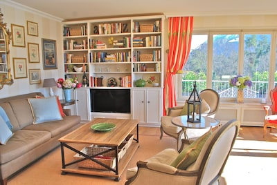 Open Living Room features elegant yet comfortable furnishings with natural light all day long through two walls of windows