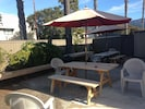 Common area w BBQ and picnic tables