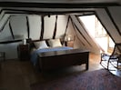 Master bedroom with original beams and large dormer window