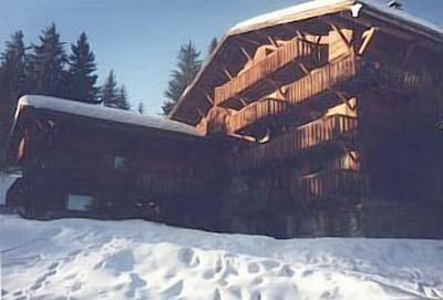 The building is of traditional chalet construction