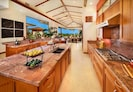 The gourmet island-styled kitchen is fully open to the great room.
