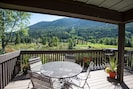 Outdoor living with  unobstructed views of creek, lake, park and mountains