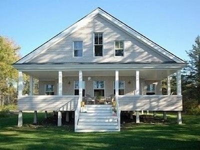 Cottage front with porch with ocean views to the west for beautiful sunsets