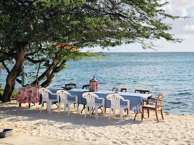 Dinner table in front of water