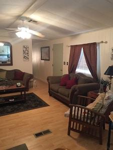 Living room. All hardwood floors.