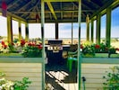 Geranium filled Oceanfront gazebo with grill and seating