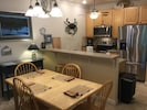 """DINING AS PART OF THE """"GREAT ROOM"""" CONTAINING KITCHEN, DINING & LIVING/FAMILY"""