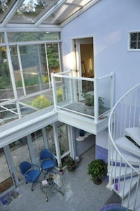 Foyer Spiral stairs to bridge