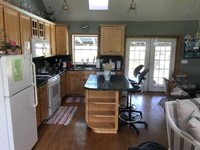 Kitchen with dishwasher, stove, microwave & fridge/freezer.