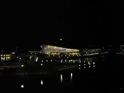 Moon coming up over The Darwin Convention Center viewed from the apartment.