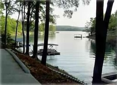 Beautiful view from this home, dock accomodates 3 to 4 boats in a quite cove.