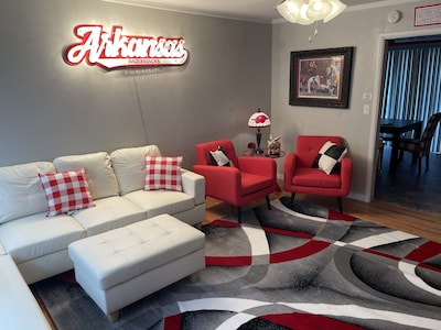 Living room, decked out in red and white for the Hogs!  Large flatscreen TV!
