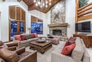Great Room with Vaulted Ceiling and Stone Firplace