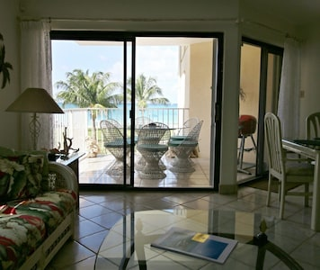 View from the living room with the ocean right there! Balcony seating for 6.